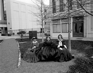 To celebrate the 150th anniversary of the inauguration of the Confederate president, Jefferson Davis, civil war re-enactors hold a rally in Montgomery, the first capital of the Confederacy. Perhaps by coincidence, these women, waiting for the rally to begin, are sitting on the park bench where Rosa Parks boarded the city bus she was arrested on in 1955, which helped launch the civil rights movement