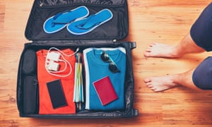 Essential holiday supplies packed in a suitcase.