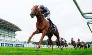Jockey Emmet McNamara rides Serpentine to victory in the Derby.