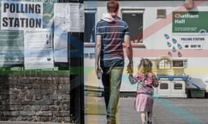 A man and his daughter head into a polling station in Battersea in London during May's European elections.