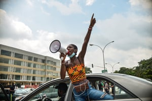 Ella, a young Nigerian woman, lending her voice in the nationwide protest calling for an end to police brutality