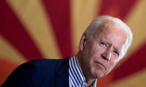 Joe Biden pauses while speaking to supporters in front of an Arizona state flag, in Phoenix this month.