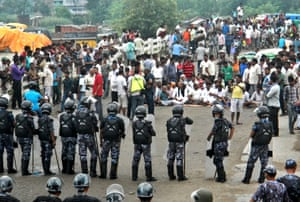 In Birgunj, Nepalese policemen face protestors belonging to ethnic and religious groups dissatisfied with Nepal's new constitution