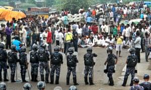 Nepalese police face protesters in Birgunj.