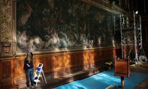 Conservators work on Daniel Maclise's murals.