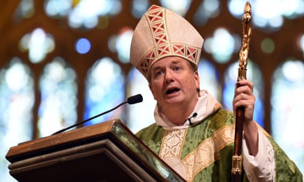 Catholic Archbishop of Sydney, Anthony Fisher, delivers a homily at the pulpit of a church.