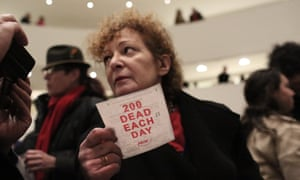 The photographer Nan Goldin leads a protest at the Guggenheim Museum over its funding from the Sackler family.