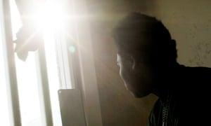 Prisoner looking through window