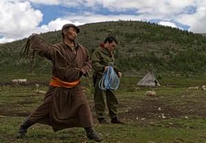 Ganbat practises the lasso with other reindeer herders in the summer Dukha encampment