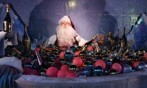 Santa Claus having a 'bauble' bath in one of the Selfridges installations