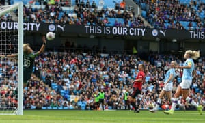 A paying crowd of 31,213 watch Manchester City Women's Ellie Roebuck saves a shot from Manchester United Women's Jane Ross at the Etihad Stadium
