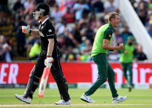 Chris Morris of South Africa celebrates as Jimmy Neesham heads back to the pavilion.