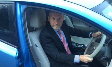 Tim O'Leary with his electric Nissan Leaf