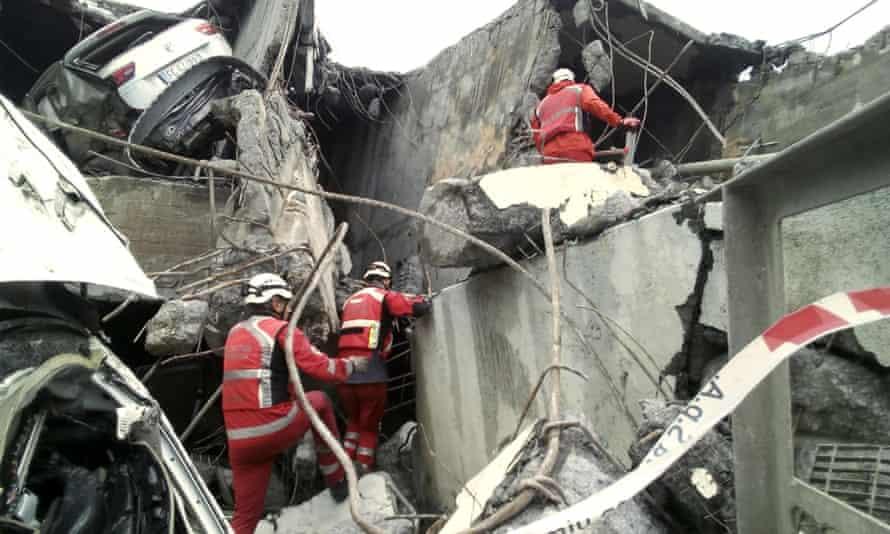 Italian Red Cross workers amid the rubble of the Morandi bridge