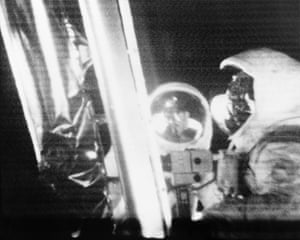 Astronauts Armstrong and Aldrin are seen standing by the Eagle's ladder. During 2½ hours of surface exploration, the two collected 47 pounds of lunar surface material for analysis back on Earth
