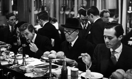 A group of diners at Pimm's snack bar in the City of London, 1951.