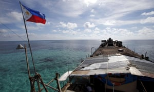 The Philippines national flag flies on the Sierra Madre at Second Thomas Shoal