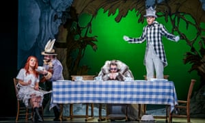 Alice with Peter Tantsits as the March Hare, Hilary Summers as the Dormouse and Sam Furness as the Mad Hatter.