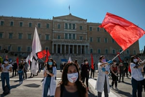 Athens, Greece: Members of the Greek Labour Union (PAME), wearing protective masks and respecting the physical distances against the spread of coronavirus, protest in front of the Greek parliament during a demonstration