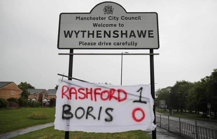 """A """"Rashford 1, Boris 0"""" banner in Wythenshawe, Manchster, after Britain's Prime Minister Boris Johnson and government in England agreed to extend free school meals during the summer holidays for struggling families in England, bowing to pressure from England football player Marcus Rashford following the outbreak of coronavirus, June 16, 2020"""