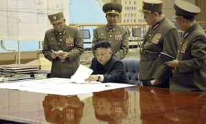 Kim Jong-un discussing military strategy on the peninsula with his generals.