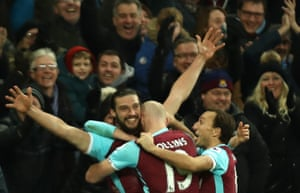 A joyous Andy Carroll and some happy Hammers.