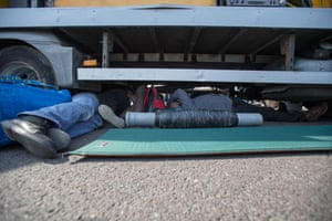 Extinction Rebellion activists lock themselves underneath a van