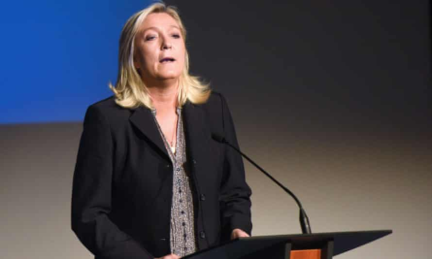 Marine Le Pen gives a press conference to announce her candidacy for regional elections.