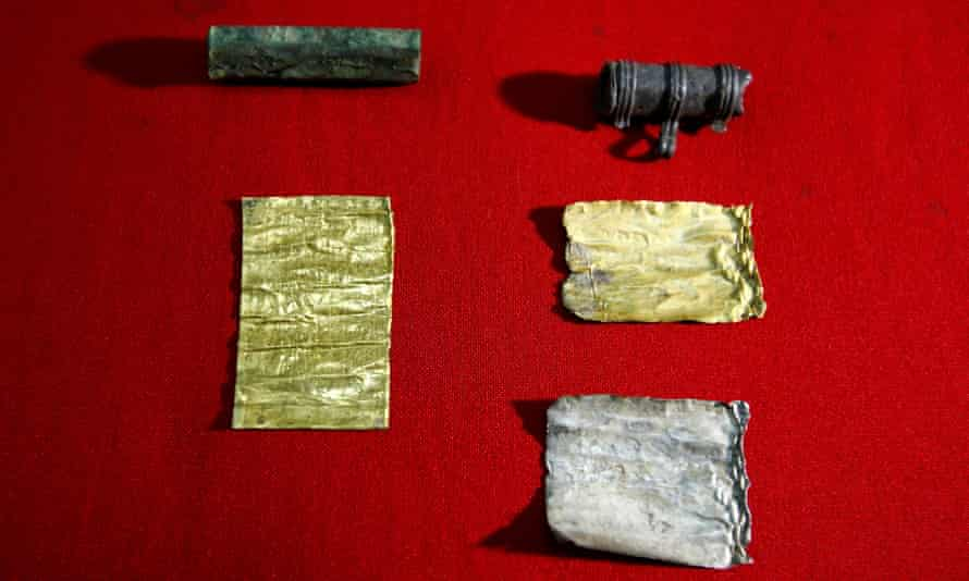 Two amulets have been discovered, containing rolls of silver and gold