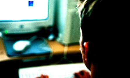 Adolescent Boy using Computer