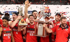 The Perth Wildcats celebrate their NBL grand final triumph after sealing the series with victory over Melbourne United in game four at Melbourne Arena.