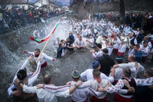 Kalofer, Bulgaria – Men celebrate Epiphany with a traditional horo, or folk dance, in the icy Tundzha river.
