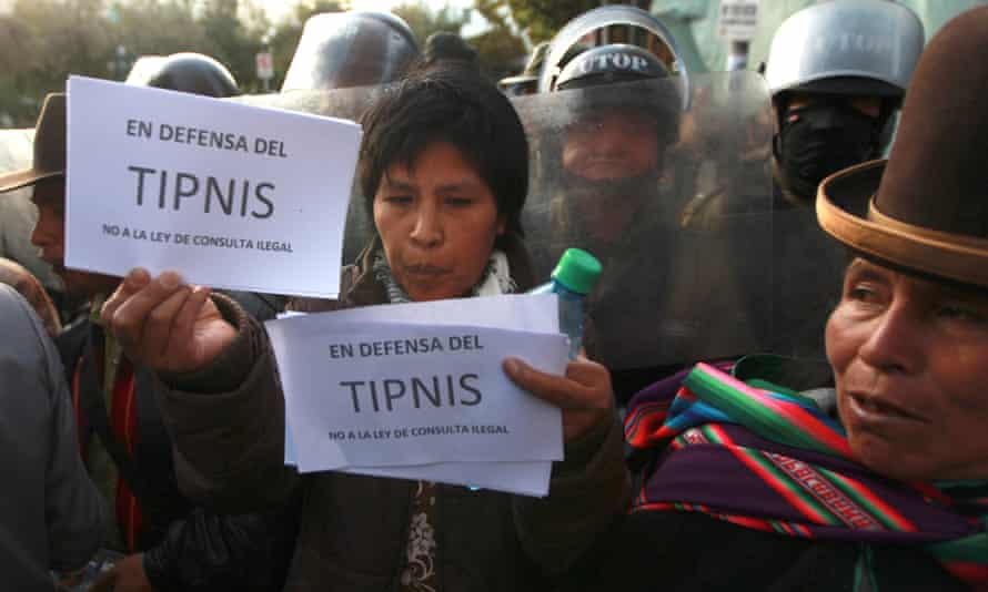 A protestor holds up a sign that reads in Spanish: 'In defence of Tipnis – no to the illegal bill of consultation', during a rally outside the National Congress building in La Paz, 2012