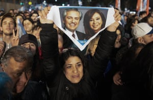 Buenos Aires, Argentina: A supporter of the presidential candidate Alberto Fernández holds up a handkerchief with photos of him and his running mate, the former president Cristina Fernández de Kirchner