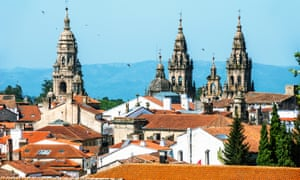 The spires of Santiago de Compostela's cathedral rise above rooftops.