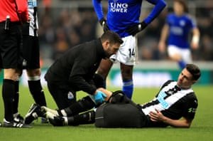 Another Newcastle player goes down as Fabian Schar receives treatment.