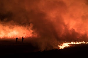 Firefighters tackle a blaze on moorland above the village of Marsden, northwest England.