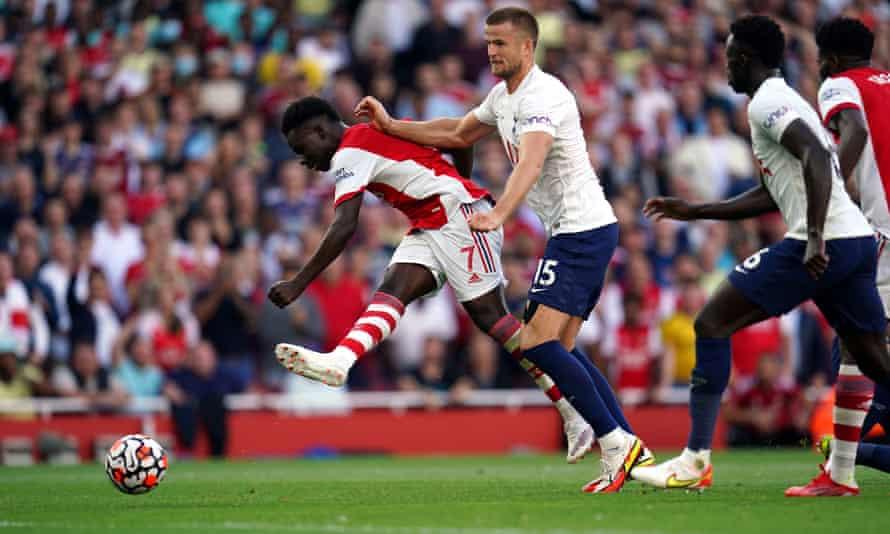 Arsenal's Bukayo Saka holds off Eric Dier to scores the third goal against Tottenham at the Emirates Stadium.
