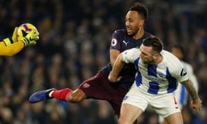 Arsenal's Pierre-Emerick Aubameyang tussles with Brighton's Shane Duffy as Seagulls' keeper Mathew Ryan grabs the ball.