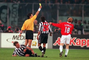 Manchester United's Paul Scholes is booked after his tackle on Juventus' Didier Deschamps.