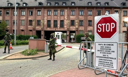 US soldiers stand guard at the entrance of the US Campbell Barracks in Heidelberg in 2002.