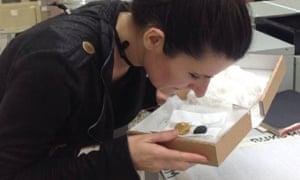 Researcher Caro Verbeek smells a pomander.