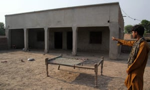 A villager points to a house where a teenage girl was raped in Muzaffarabad, a suburb of the central city of Multan.