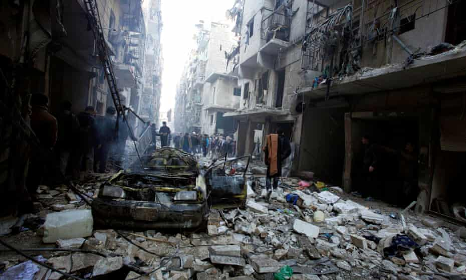 People look for survivors after an airstrike in eastern Aleppo, Syria, 2013.