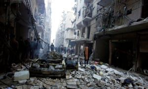 Residents search for survivors following an airstrike on the Takeek Al-Bab area of Aleppo, Syria, in December 2013