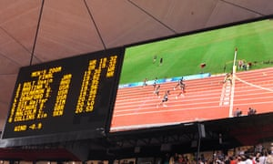 A big-screen replay shows Bolt's world record time of 19.30sec at the Beijing Olympic Games in 2008.