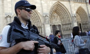 A police officer in front of Notre Dame Cathedral in Paris days after the attempted attack