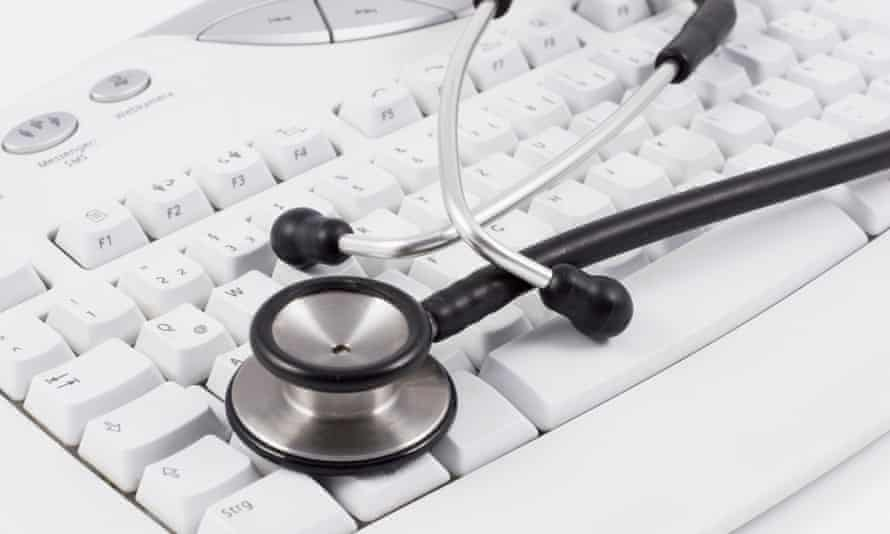 A stethoscope lying on a computer keyboard
