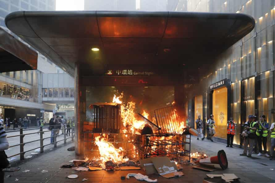 A fire set by protesters burns at an entrance to the Central MTR subway station in Hong Kong.