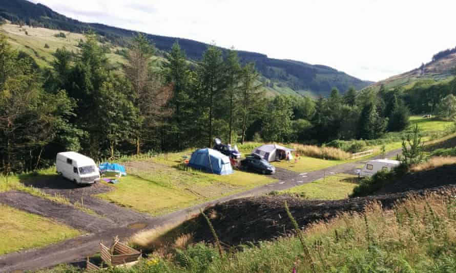Cars, campervans and tents at Willow Springs, Afan Forest Park, Wales